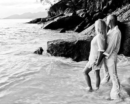 This image shows Seychelles Photographer taking photos of a wedding couple