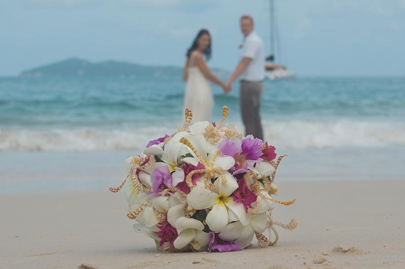 This photo shows bridal bouquet an wedding rings