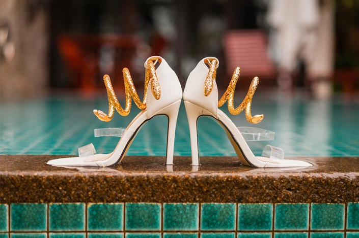This photo shows bridal high heels at the hotel pool
