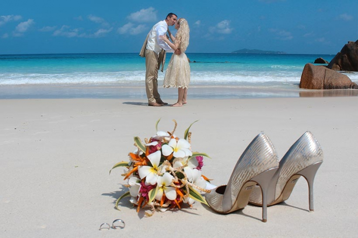 This photo shows the bides' shoes at the beach
