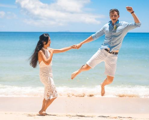 wedding couple beach fun