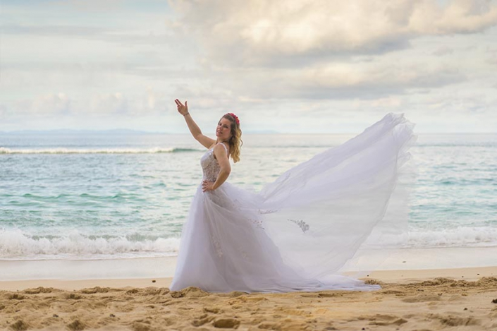 This photo shows a posing with a lovely dress at the beach on Mahe