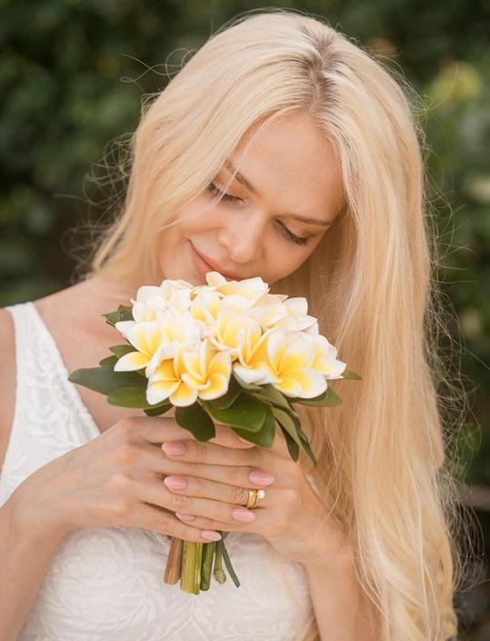 This photo shows a bride portrait with Frangipani bouquet