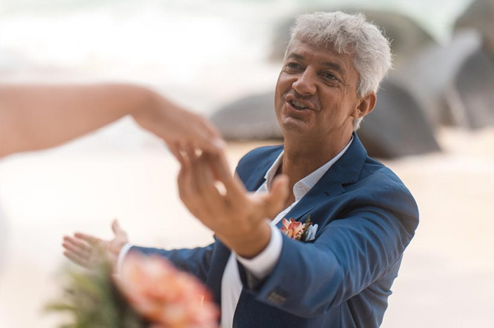This photo shows a closeup of the groom at the beach on Mahe