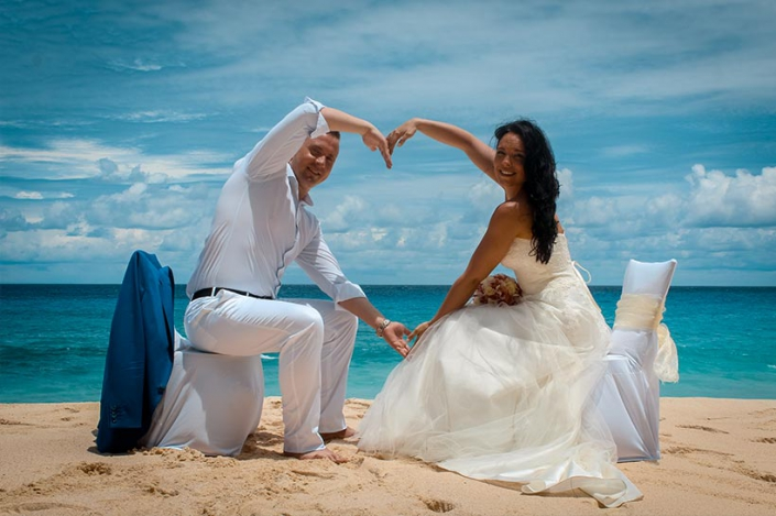 This photo shows a gleeful couple at the beach Praslin