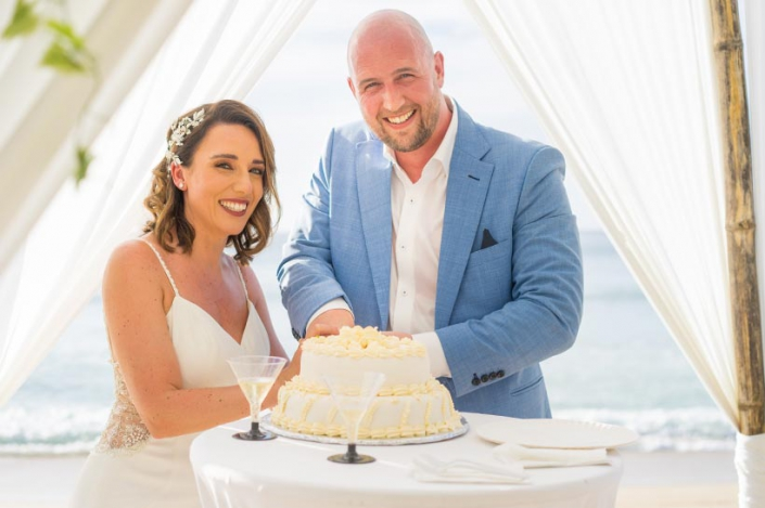 This photo shows a couple cutting the wedding cake