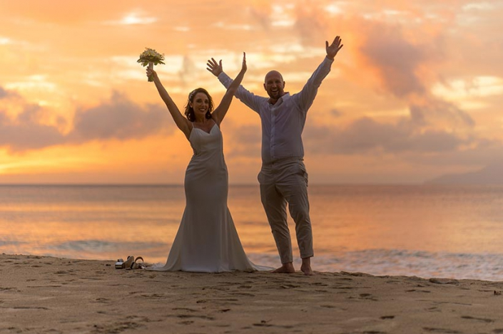 This photo shows a happy couple at the beach at sunset, Bel Ombre Mahe