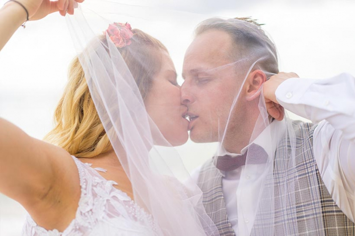 This photo shows a kissing couple under the veil