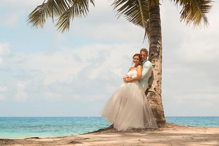 This photo shows couple portrait under a palmtree