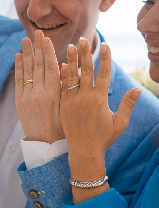 This photo shows the couples' hand showing theri wedding rings