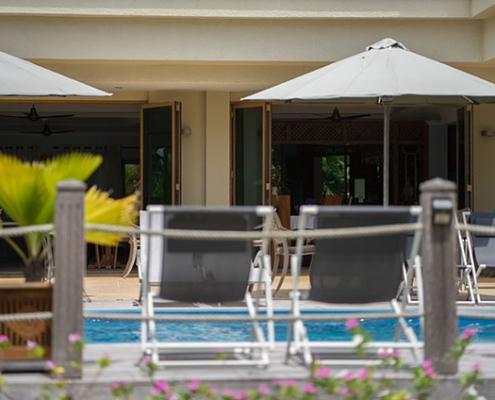 Crown Beach Hotel chairs pool