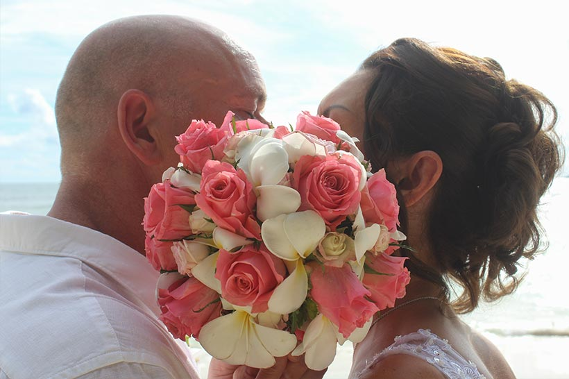 This Photo shows a jovial couple kissing