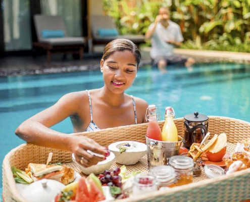 This shows a photo of the Story Resort honeymoon clients having breakfast
