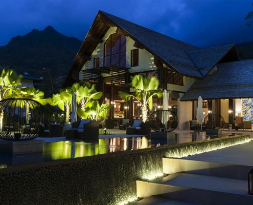 This shows a photo of the Story Resort main building at night