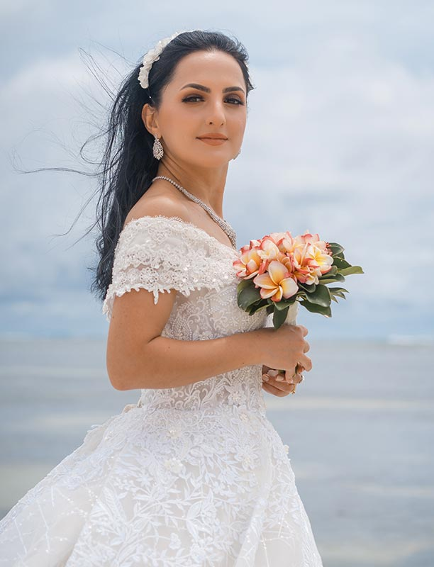 This photo shows stunning bride portrait captured at the beach on Mahe