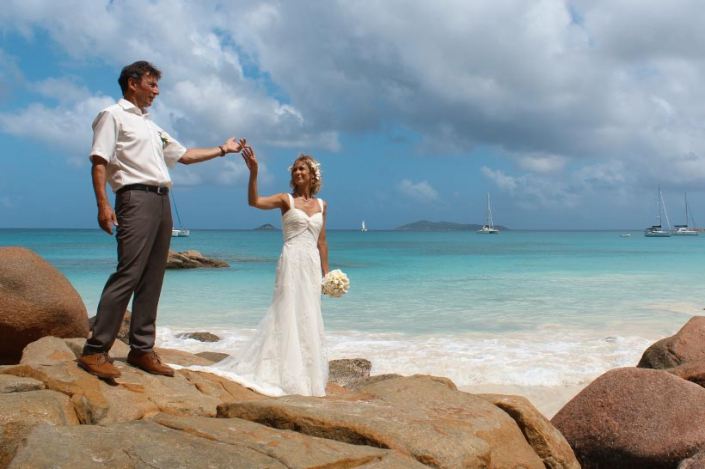 This Photo shows untoubled wedding couple holding hands