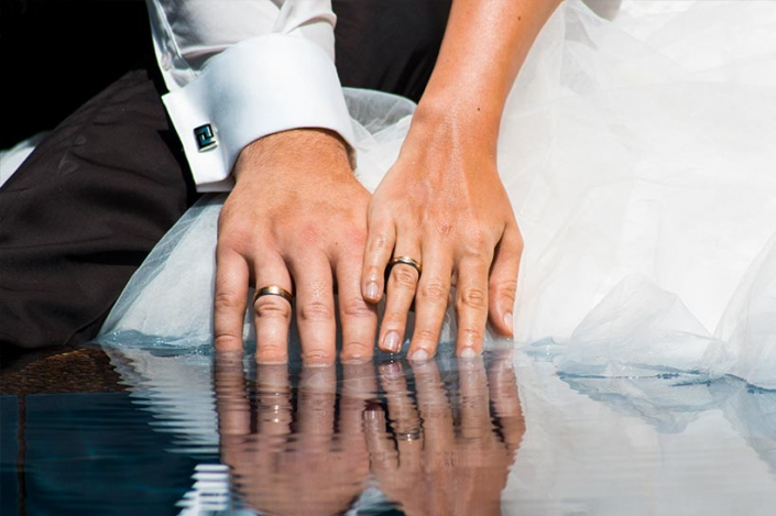 This Photo shows the reflection of the wedding rings in the water
